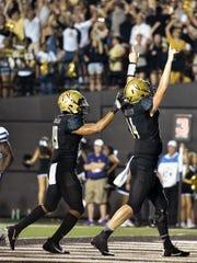 Vanderbilt quarterback Kyle Shurmur (14) reacts to