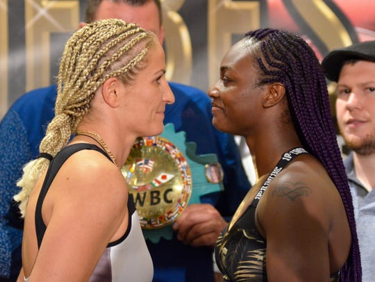 Claressa Shields and Nikki Adler pose after the weigh-in