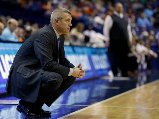 Indiana State coach Greg Lansing watches calmly from the sidelines against Evansville in the semifinals of the Missouri Valley Conference men's tournament, March 5, 2016, in St. Louis.