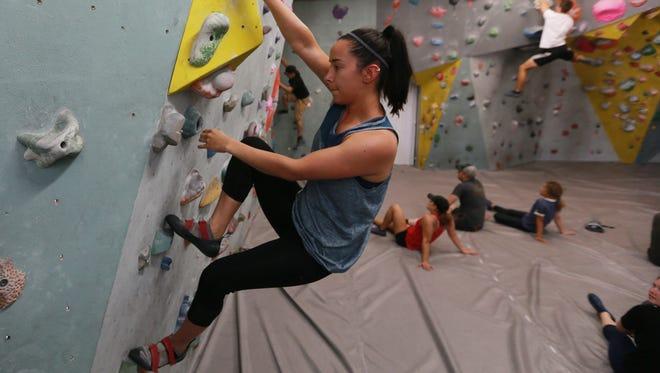 Andrea Carlos negotiates a wall at Cave Climbing Gym in El Paso.