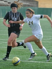 Rider junior Keeley Ayala (24) charges past Canyon