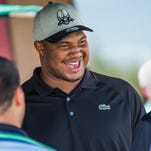 Calais Campbell meets attendees of the 4th Annual Calais Campbell Charity Golf Classic at Whirlwind Golf Club, Friday, May 20, 2016.