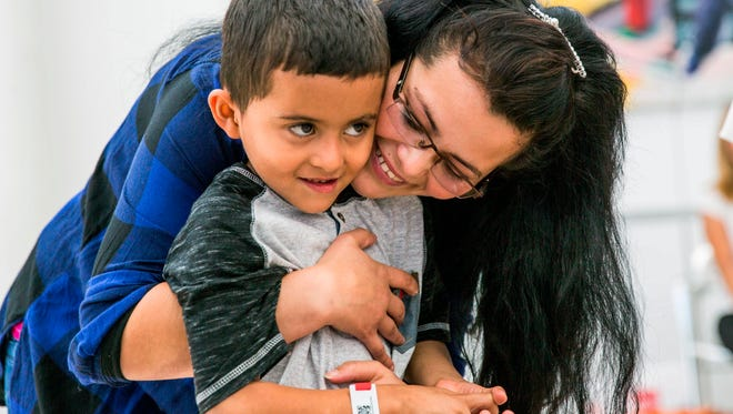 Yolany Padilla is reunited with her son Jeslin in the Seattle-Tacoma International Airport after nearly two months of separation on July 14, 2018, in Seattle.