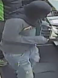 A surveillance photograph of a man who robbed an Express Convenience Center in Bellevue on Sept. 7
