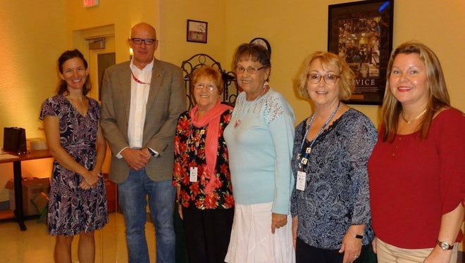 Attending the Master Gardeners awards program were, from left, Urban Horticulture Agent Kate Rotindo; St. Lucie County Deputy Administrator Mark Satterlee; President Brenda Gustafson; President Elect Pat Kraus; Secretary Judy Wade; Education Outreach Coordinator Kate O'Neill