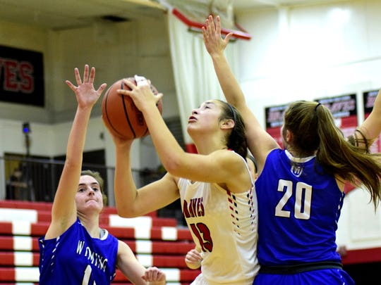 "Maddie Antenucci of Indian Hill bags an ""and one"" opportunity."