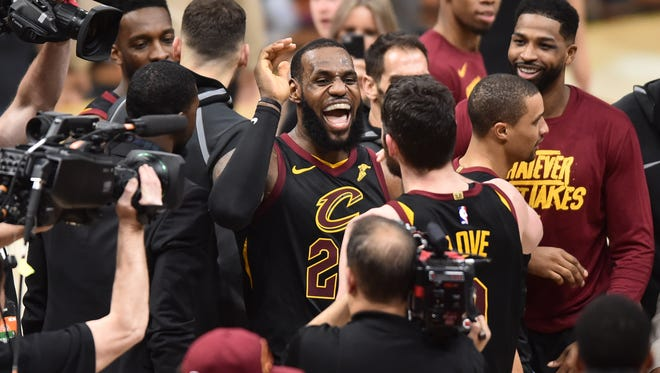 Cleveland Cavaliers forward LeBron James (23) celebrates teammates after hitting the final basket to win the game against the Toronto Raptors in game three of the second round of the 2018 NBA Playoffs at Quicken Loans Arena.