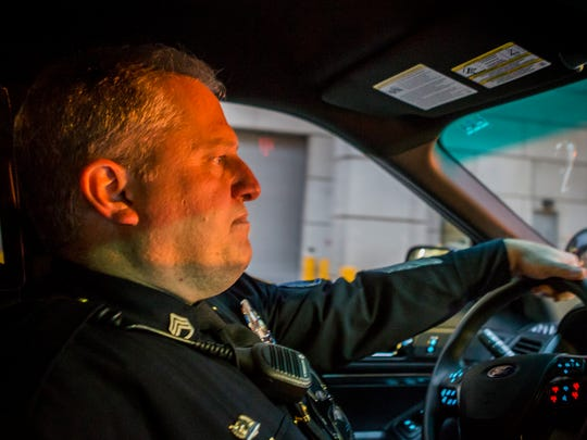 Then-Sgt. Bill Schmid, of the Wilmington Police Department, drives his car through the streets of Wilmington on patrol Sunday night, Dec. 18, 2016.