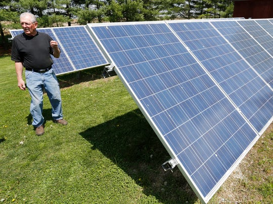 """Jim Couk talks about the solar panels Wednesday, April 26, 2017, at his farm near Pyrmont. Couk began installing solar panels at his farm in 2013. """"You have to think beyond yourself and think about what you are doing for the environment,"""" he said."""