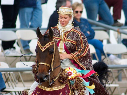 In the Mounted Native Costume event, riders and horses