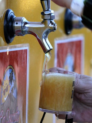A number of beverage companies, mostly craft breweries and other beer providers, attended the Brew at the Zoo. Beer is poured during the Brew at the Zoo event held at The Living Desert on Saturday, May 3, 2014.