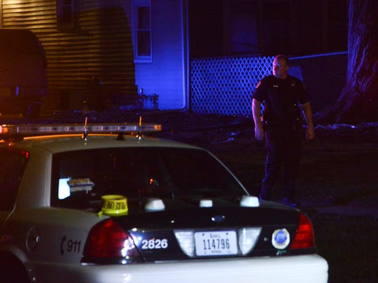Police investigate a fatal shooting Friday night at East 30th Street and Garfield Avenue in Des Moines.
