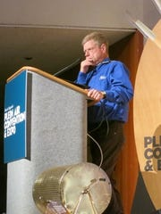 Steve Doherty stands at the podium at the Plein Air Convention and Expo in Monterey, CA in 2014.