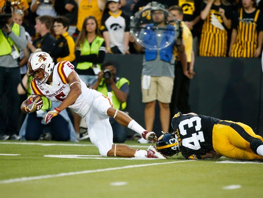 Iowa linebacker Josie Jewell trips up Iowa State receiver
