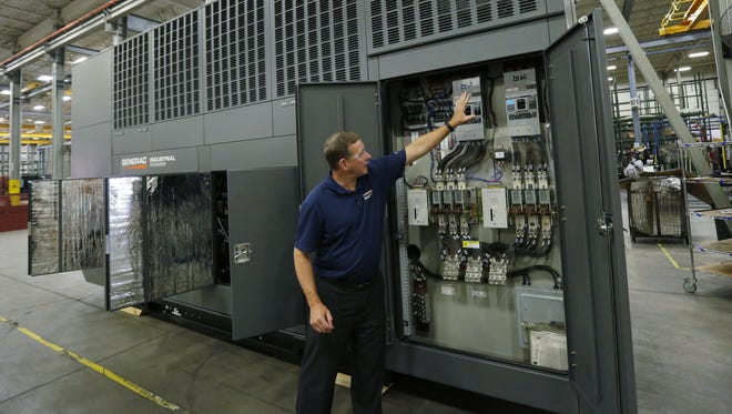 Mike Kirchner, technical sales manager for Generac Power Systems, show components in a 1-megawatt generator that will run through testing procedures during a media tour Thursday, Aug. 10, 2017, at the company's Oshkosh facility. Generac makes 150-kilowatt to 2 megawatt diesel and natural gas generators.