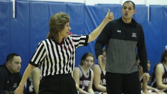 Referee Donna Sporfford during a Section 1 Class A girls basketball quarterfinal at Walter Panas Feb. 23, 2017.