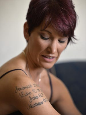 Kelly Doss, a St. Cloud woman who is in recovery from anorexia, talks about the Bible verse tattoos she has in spring 2015. Faith has helped in her recovery from the disease. Now, she leads a support group for people suffering from eating disorders.