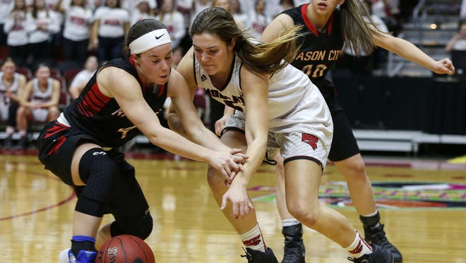 Mason City senior Rachel Danielson, left, collides with Western Dubuque's Jessica Cartee during the Iowa high school girls' state basketball tournament on Tuesday at Wells Fargo Arena in Des Moines.