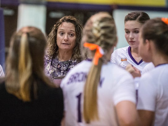 Bronson's coach Jean LaClair talks to her player during