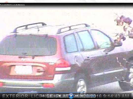 Police said a repeat Wal-Mart robber fled in this maroon-over-gray Hyundai Santa Fe after robbing the West Manchester Wal-Mart on Nov. 28, 2016.