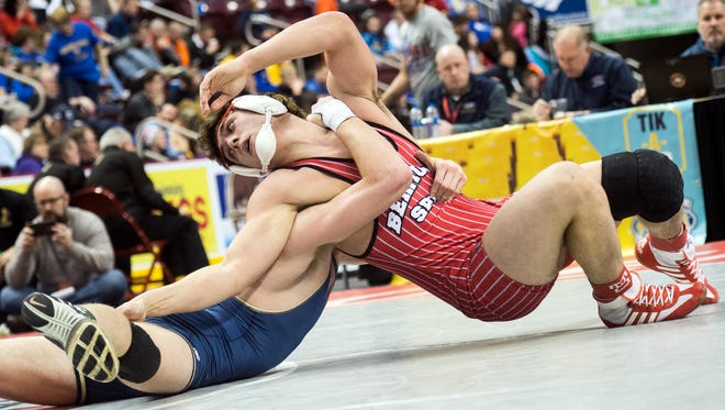 Bermudian Springs' Chase Dull, right, works around McGuffey's Dalton Lough during a 195-pound match at Hershey's Giant Center for the PIAA 2A Championships, Thursday, March 8, 2018. Dull won, 13-4.