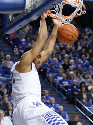 Kentucky's Karl-Anthony Towns dunks during the first half of an NCAA college basketball game against Eastern Kentucky, Sunday, Dec. 7, 2014. (AP Photo/James Crisp)