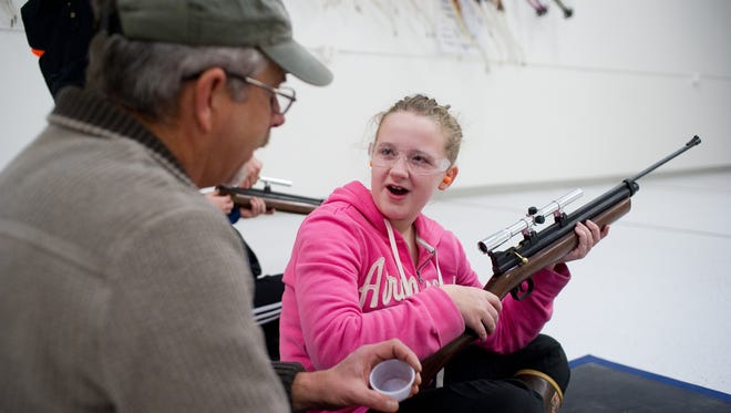 A sixth-grader learns how to use a rifle in 2012 in Juneau, Alaska.