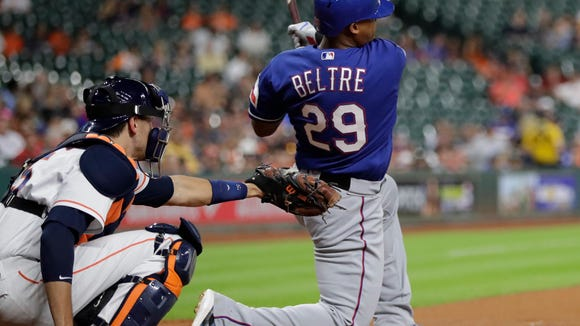 Texas Rangers' Adrian Beltre (29) watches his home