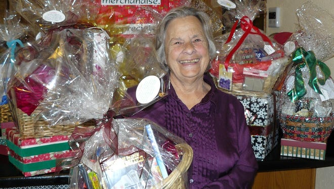 Event chairwoman Vera MacGregor prepares for Saturday's Tantalizing Gourmet Delights, Holiday Baskets and Sweet Sale, presented by the Silver City Woman's Club.