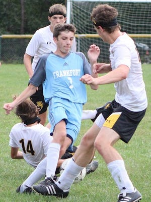Frankfort's Levi Sgaggero navigates his way through traffic. Sgaggero scored two of Frankfort's three goals to lead the Falcons to a 3-2 victory over Keyser. Tribune photo by Chapin Jewell