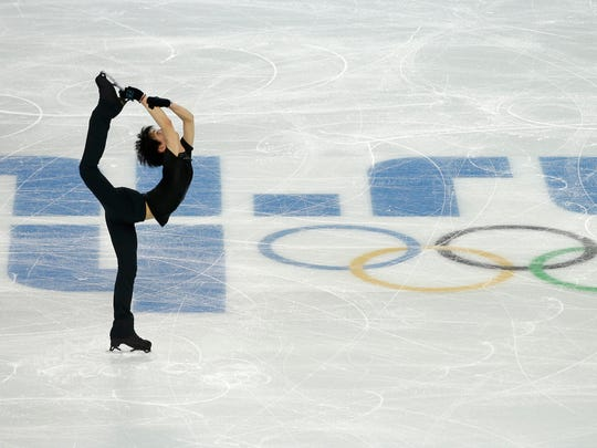Yuzuru Hanyu of Japan practices during a training session at the Iceberg Skating Palace ahead of the 2014 Winter Olympics, Feb. 5, 2014, in Sochi, Russia.