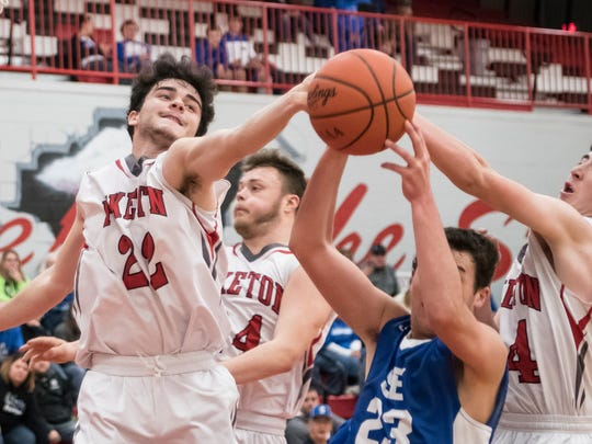 Piketon's Tanner Perdue blocks a shot attempt from Southeastern's Noah Dresbach during the Redstreaks' 52-49 win over the Panthers Friday night at Piketon High School.