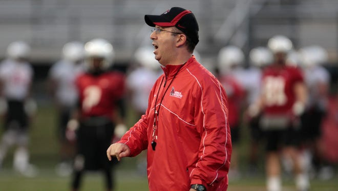 FILE - Ball State coach Pete Lembo speaks to players during practice, July 31, 2013.