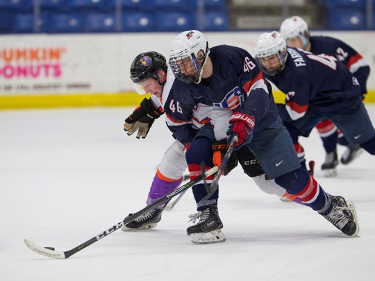 Team USA's Patrick Moynihan (46) battles a Youngstown