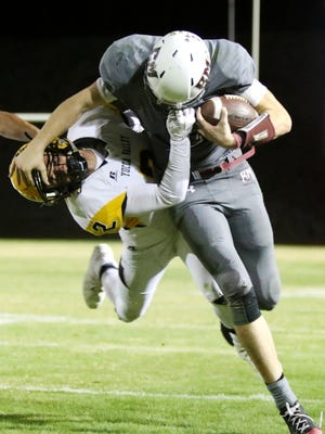 Rancho Mirage's quarterback David Talley fights off Yucca Valley's Reuben Schmit in Rancho Mirage on Friday, October 20, 2017.