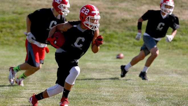 Central Panthers H-back Isaiah Abraham (22) with the ball during practice, Monday, August 17, 2015, in Independence, Ore.