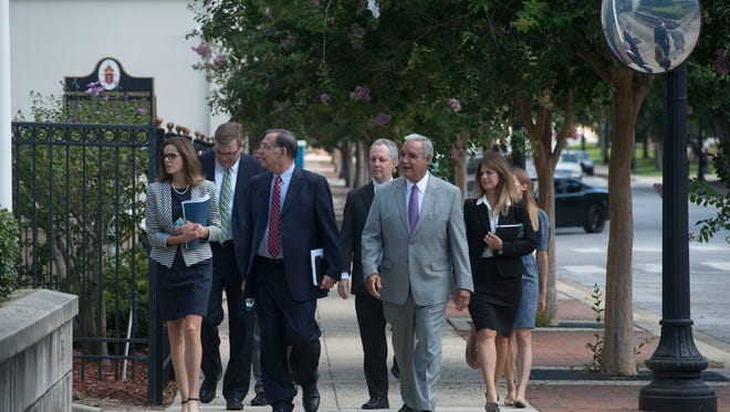 Federal Judge Casey Rodgers, right center, takes Sen. John Boozeman, center, and Rep. Jeff Miller, right, and a group of other officials on a tour of the closed federal courthouse in downtown Pensacola. The mold issues and water intrusion forced the closure of the building last summer.