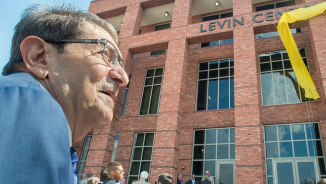 Attorney and Donor Fred Levin watches as the name is unveiled during the  ribbon cutting ceremony at the Levin Center For IHMC Research in Pensacola on Monday, September 26, 2016.