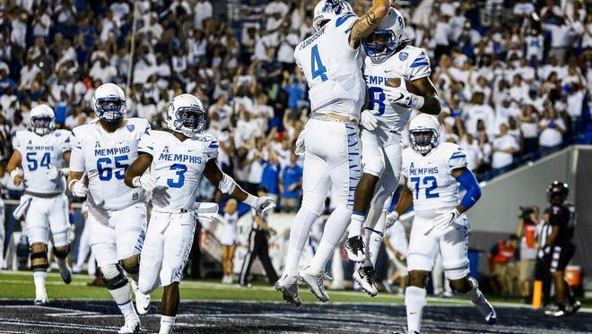 University of Memphis running backs  Darrell Henderson (left) celebrates with quarterback Riley Ferguson (left) after scoring a touchdown adjacent the Temple defense at Liberty Bowl Memorial Stadium.