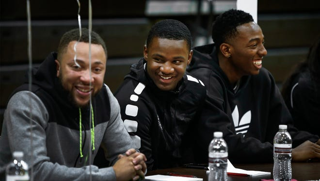 East High School basketball player Alex Lomax (middle) jokes with teammates, after being named district preseason player of the year during the first annual District 16 AAA basketball media day at Whitehaven High School on Wednesday, Nov. 9, 2016.