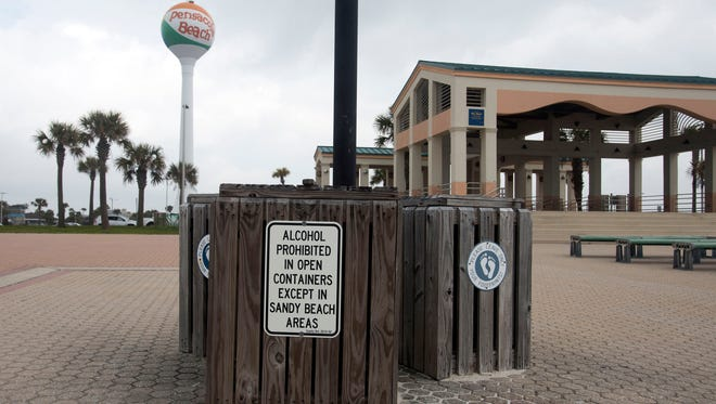 A sign at Pensacola Beach in February 2016 states that alcohol is banned in open containers, except in sandy beach areas.