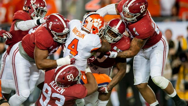 Clemson quarterback Deshaun Watson (4) is swarmed under by Alabama defensive lineman Da'Shawn Hand (9), defensive lineman Jonathan Allen (93), linebacker Reuben Foster (10) and linebacker Ryan Anderson (22) in first half action of the College Football Playoff National Championship Game at Raymond James Stadium in Tampa, Fla. on Monday January 9, 2017.