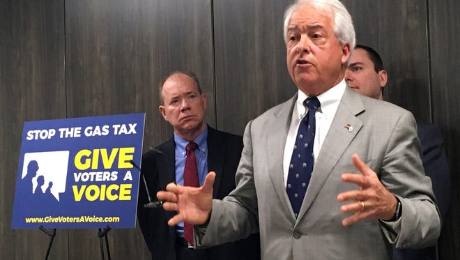 "California Republican gubernatorial candidate John Cox, right, speaks in Sacramento on Wednesday about his decision to spend ""significant"" money on an effort to repeal California's newly passed gas and diesel tax increase. Cox is joined by Jon Coupal, president of the Howard Jarvis Taxpayers Association, at left."