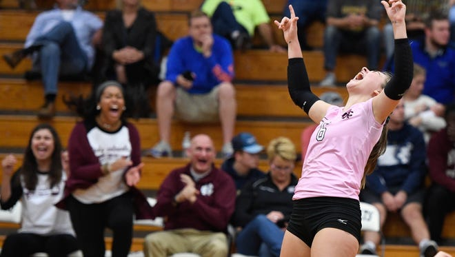 Henderson's Cayce Chaykowsky (6) celebrates after the Lady Colonels beat Caldwell County in the Second Region Volleyball Tournament championship at Trigg County High School Thursday, October 26, 2017.