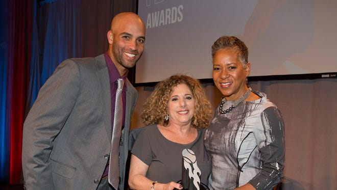 James Blake (USTA Foundation President) Katrina Adams (USTA CEO) are pictured with Carol Cohen (Center) after receiving the Eve Craft Community Service Award