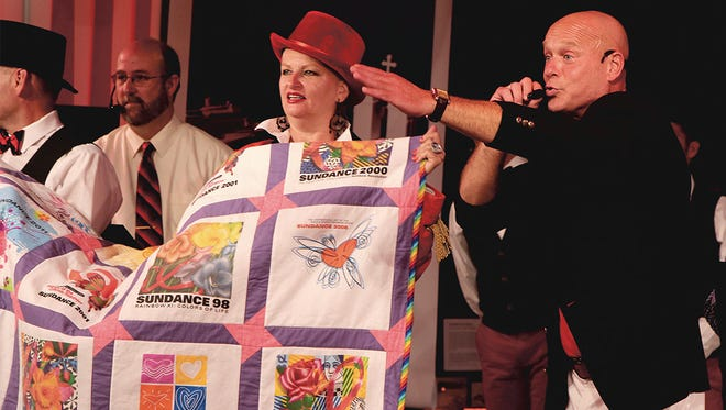 Auctioneer Lorne Crawford sells a quilt made of former Sundance T-shirts at the 2016 Sundance. It sold for $9,000.