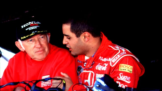 Engineer Morris Nunn (left) goes over the chassis setup with Juan Pablo Montoya at Nazareth Speedway.