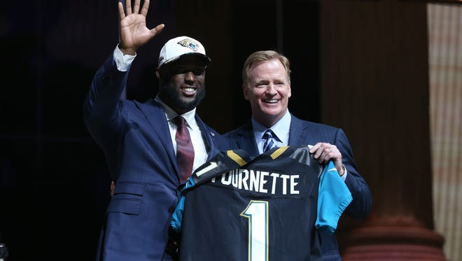 Former LSU running back Leonard Fournette poses with NFL commissioner Roger Goodell after he was selected with the No. 4 overall pick by the Carolina Panthers.