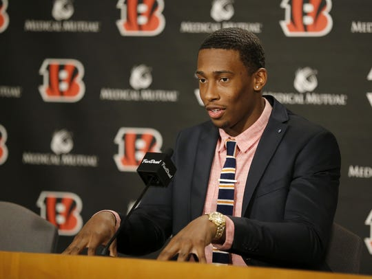 Cincinnati Bengals safety George Iloka talks in a press