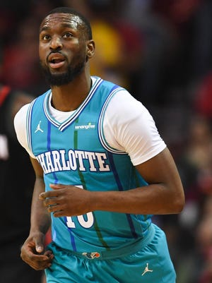 Charlotte Hornets guard Kemba Walker (15) reacts after a shot during the first quarter against the Houston Rockets at Toyota Center.